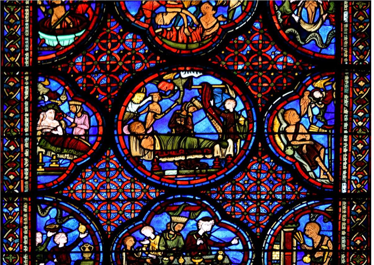 Vitrail de Lazare et du mauvais Riche dans la cathédrale de Bourges. XIIIe siècle